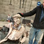 The bronzed Man on the Bench being welded together